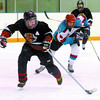 Citizen photo by David Mah Prince George Midget Cougar Parker breaks away from Connor O'Rourke of Kelowna in a last minute effort Saturday.