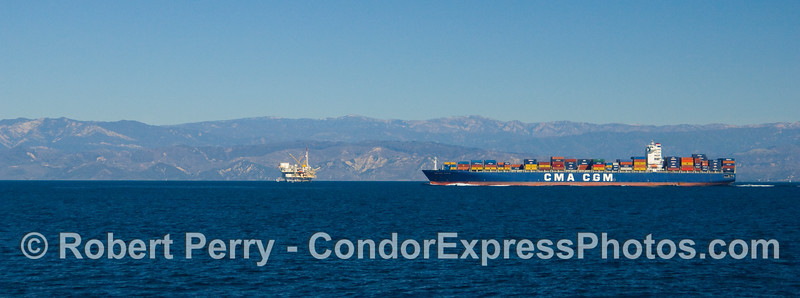 "Panoramic view of the container vessel ""CMA CGM Vivaldi"" northbound in the shipping lanes, Santa Barbara Channel.  Oil Platform Gail is visible in the background."