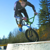 Citizen photo by Chuck Nisbett  Extended Season - Clint Clarke, 18, performs a Foot Jam on the top of the Tombstone at the Rotary Skatepark Monday afternoon.  Clarke and his friends were taking advantage of the warm sunny afternoon to do a some trick biking at the park.