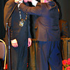 Citizen photo by Chuck Nisbett Incoming mayor Dan Rogers receives the chain of office from outgoing mayor Colin Kinsley after taking his oath of office at the PG Playhouse Monday evening following a short council meeting for the outgoing council.