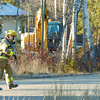 Citizen photo by Brent Braaten City of Prince George fire fighter Dean Hickey on the scene of a gas leak on  Clapperton Street in front of Hospice House Tuesday afternoon. An excuvator working there hit a 2 inch gas line. Fire Department secured the scene until Tarsen Gas arrived and fixed the line.