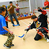 Citizen photo by Brent Braaten The Prince George cougars had a game of floor hockey with the Grade 7's at Harwin Elementary over the lunch hour Wednesday. Here Aaron Taylor, 12, scores on Cougar Colin Scherger.