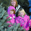 Citizen photo by Brent Braaten Angel Valley Tree Farm owner Cindy O'Neil and her two daughters Kaylee Barnes, 6, left, and Jena Barnes, 5, on the tree farm. She will be giving Christmas trees to families of troops that are deployed in Afganistan.