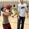 Citizen photo by Brent Braaten UNBC Timberwolves were at Harwin Elementary working with Grade 4 and 5 students with a basketball skills camp and a motivational speech. Destiny Thomas, 10, works on her skills  with the help of Sam Raphael.