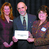 Citizen photo by David Mah Judy Neiser, left, and Bill Hellyer, of the Prince George Community Foundation present Marjory Tunney, of the Prince George Public Library with a grant.
