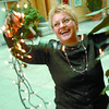 Citizen photo by Brent Braaten Audrey Faktor, with UNBC Conference and Events Services,  has some fun with lights in the administration building at UNBC. She was decorating the plants with lights to prepare for the employee recognition Friday evening.