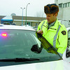 Citizen photo by David Mah RCMP Constable Del Byron check lights at the City detachment before heading out on shift.