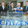 Citizen photo by Brent Braaten Kelly Zammit, Town Centre Branch manager Integris Credit Union, winners Stewart and Arlene Morrisin and Prince George Citizen Publisher Hugh Nicholson.
