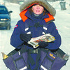 Citizen photo by David Mah Canada Post mail carrier Cheryl Orydzuk, was all bundled up so she could deliver bundles of mail to residents on Maples Street.