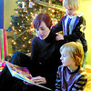 Citizen photo by David Mah Carly Koop reads to her sons Ryley, 4, standing, and Tyssen, 6. The cold weather makes for good, quiet reading time in front of the Christmas Tree.