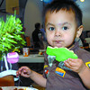 Citizen photo by Brent Braaten Kaylum French, 22 months enjoys a cookie at the St. Vincent de Paul Chritmas dinner.