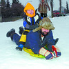 Citizen photo by Brent Braaten Sam Rivers and his son Joseph, 4, enjoy Boxing Day sliding at Carney Hill.