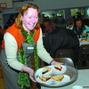 Citizen photo by Brent Braaten Kathy Norman hands out dessert at the St. Vincent de Paul Christmas dinner on Christmas day.