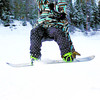 Citizen photo by David Mah Quaid Barby, 18, sports a colorful snowboard outfit as he flies off a jump at the Hart Highland Ski Hill Sunday.