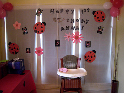 Cute homemade banner that doubles as an icing backsplash.