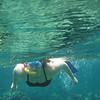 Christy snorkeling the Sandy Cay reef