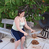 Christy whacking some coconuts
