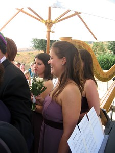 Bridesmaids Vicki (l) and Sarah watch the ceremony