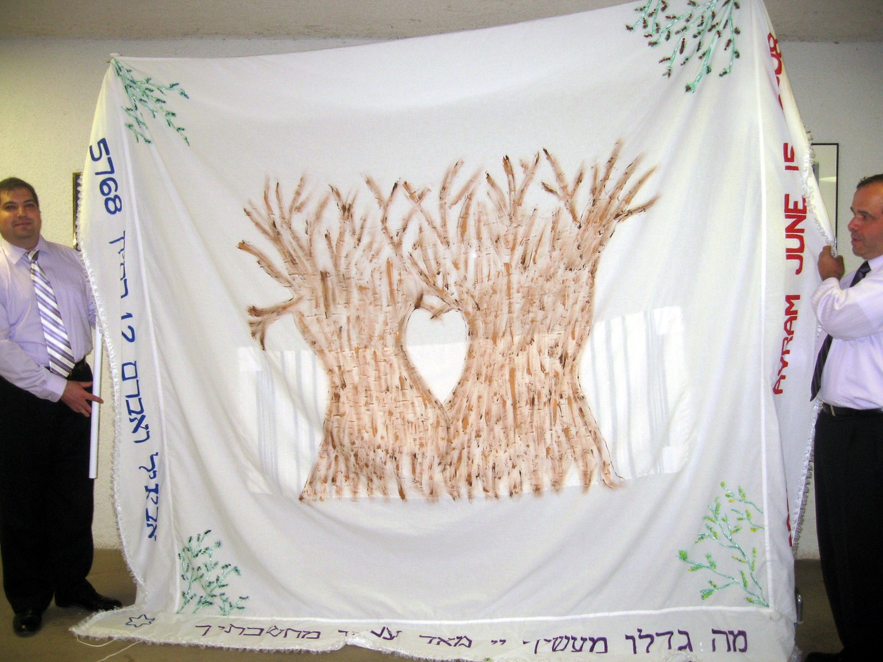 Craig (brother of the bride) and Gary (father of the bride) hold the chuppah, which was made by Karen (friend of the bride) and includes a tallit worn by Abby's grandfather and namesake, Victor