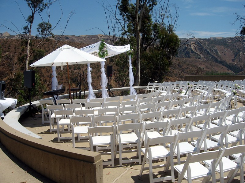 The band's umbrella and the chuppah in place during rehearsal