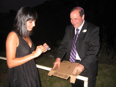 Amber and Gary prepare the sign for the back of Avram's Vespa