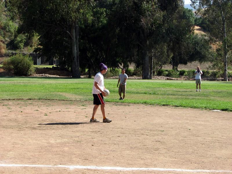 Avram surveys Team Mandell in the field