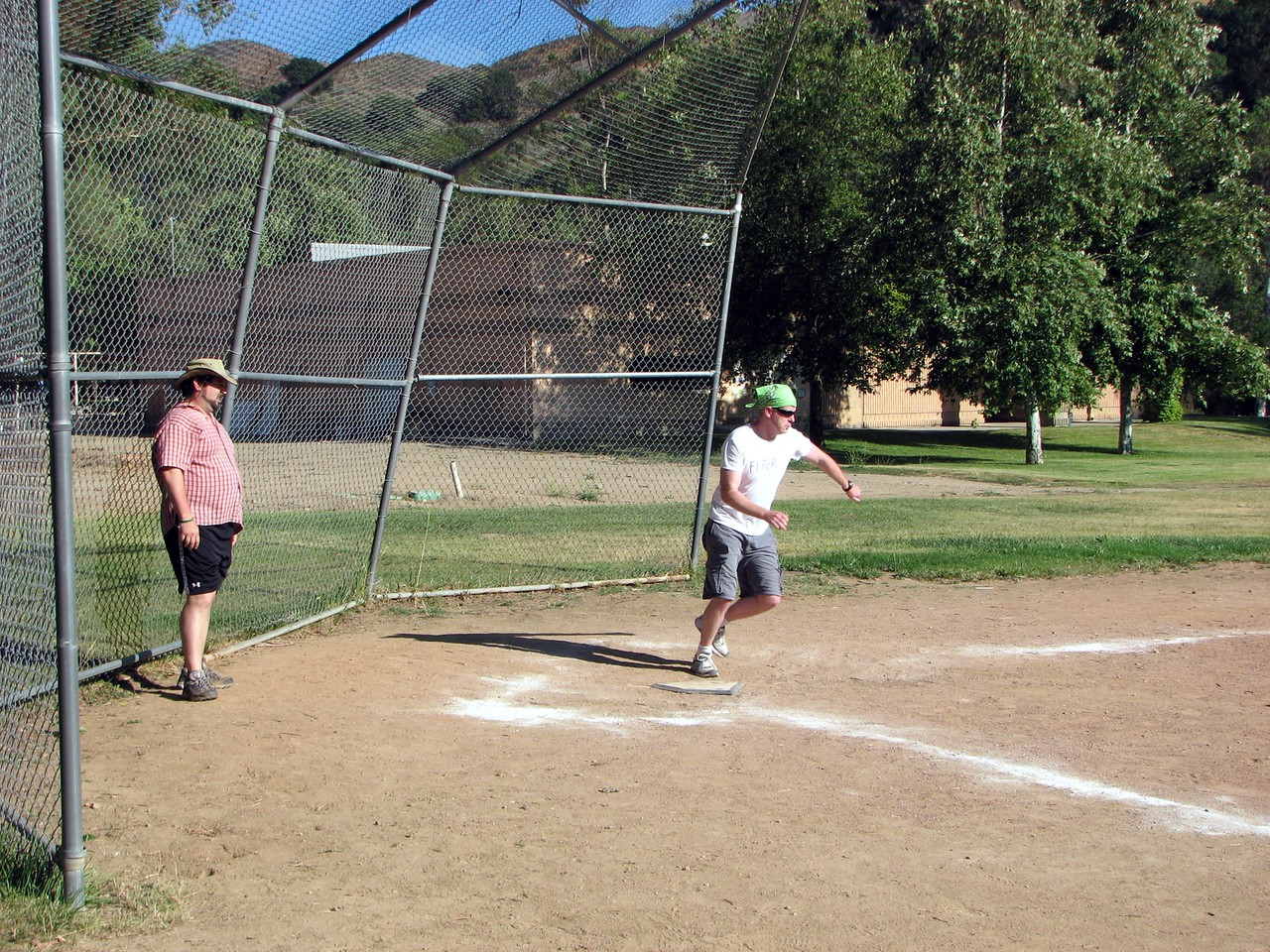 Joe (friend of the bride) at the plate for Team Fifer while Rabbi Spey (friend of the bride and groom) catches for Team Mandell