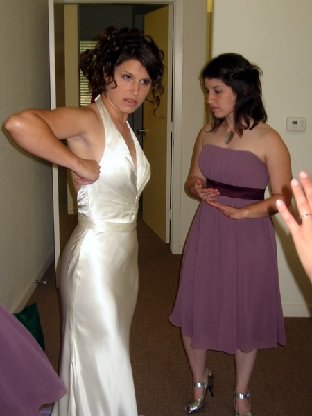 Bridesmaid Vicki helps Abby with her dress