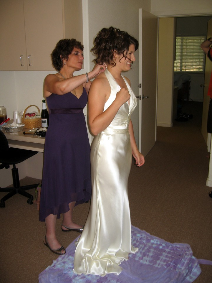 Hope (mother of the bride) helps Abby with her dress