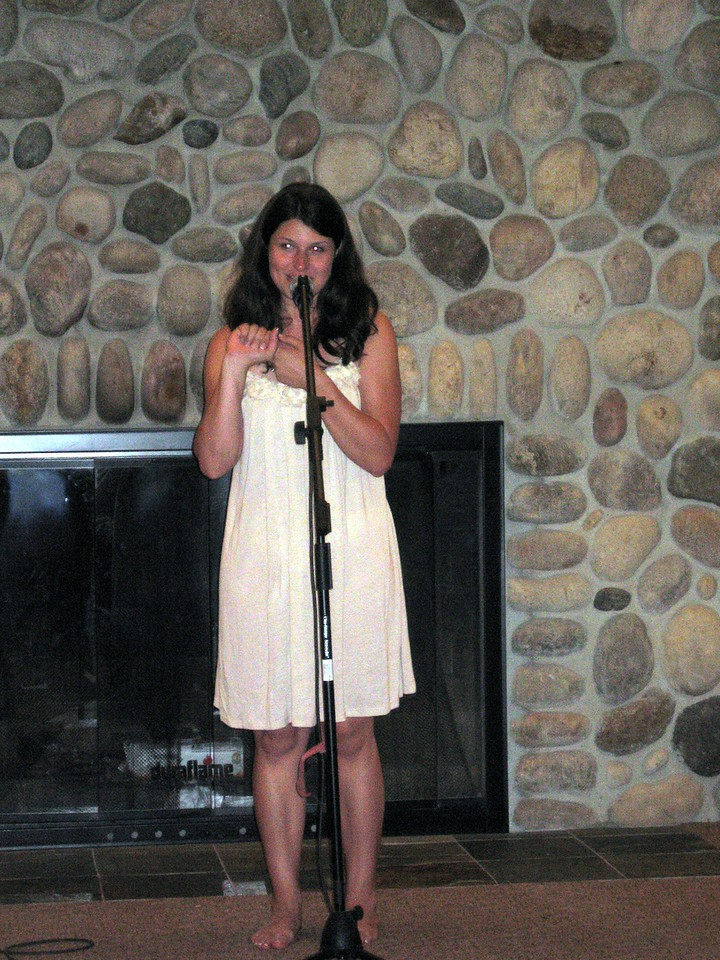 Abby thanks the guests at the talent show