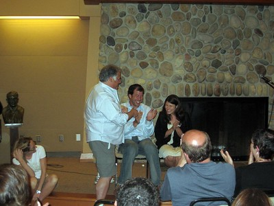 Eric (friend of the bride) performs a magic trick for Avram and Abby