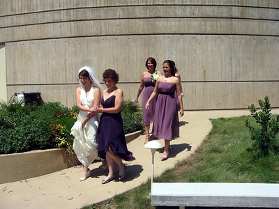 Abby is escorted by Hope (mother of the bride) and bridesmaids Courtney and Sarah