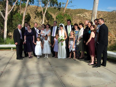 Abby and Avram with the family of the groom