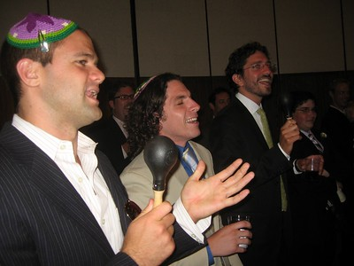 David, Noam, and Gabe (friends of the bride and groom) and Jordan (brother of the bride) interrupt Avram