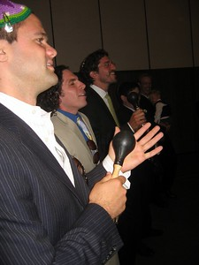 David, Noam, and Gabe (friends of the bride and groom) interrupt Avram