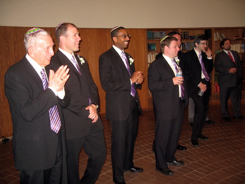 Wallace (father of the groom, left), David (brother of the groom), LaSalle (groomsman), Jann (groomsman), Hunter (stepbrother of the groom), and Rabbi Spey (friend of the bride and groom) interrupt Avram