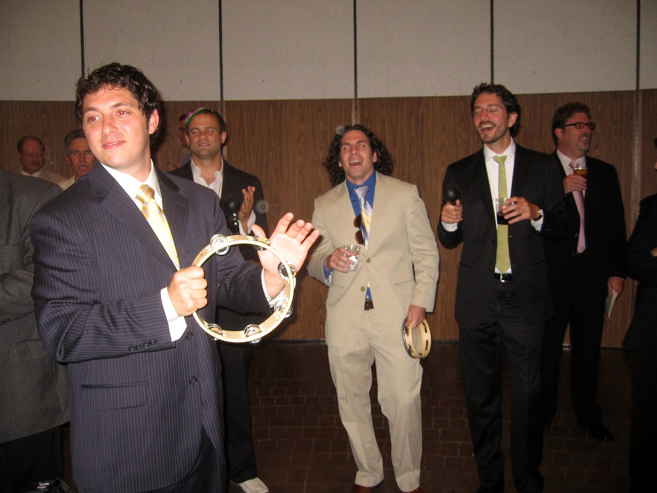 Sacha, David, Noam, and Gabe (friends of the bride and groom) interrupt Avram