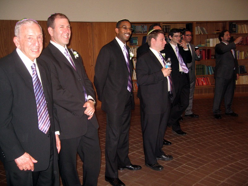 Wallace (father of the groom, left), David (brother of the groom), LaSalle (groomsman), Jann (groomsman), Hunter (stepbrother of the groom), Rabbi Delcau (friend of the groom), and Rabbi Spey (friend of the bride and groom) interrupt Avram