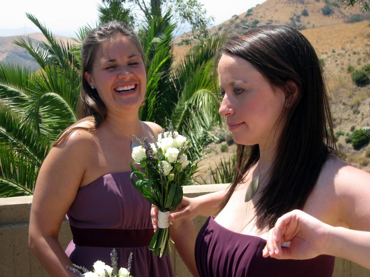 Bridesmaid Rebecca airs out while bridesmaid Sarah laughs