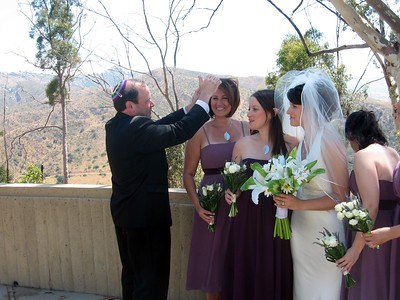 Gary (father of the bride) assists bridesmaid Courtney with her hair
