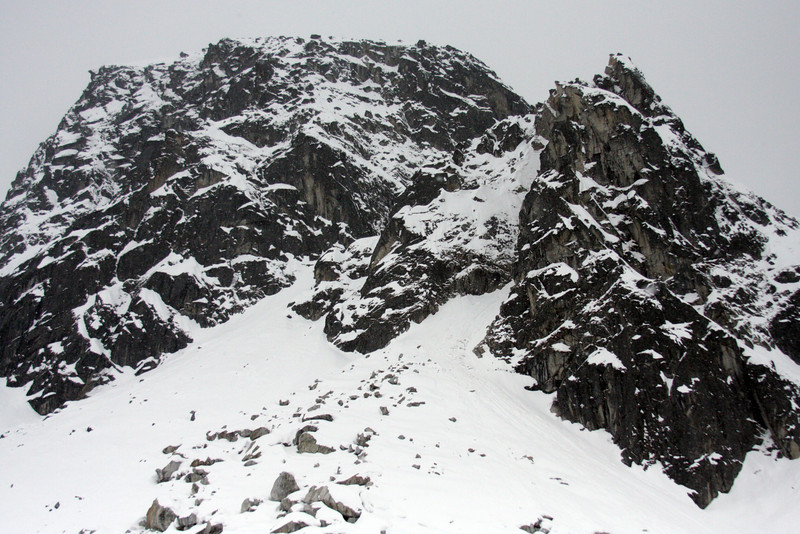 The webfoot prospect rises over Archangel Valley, colorless under the winter snow.
