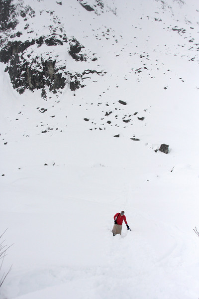 After the second episode of getting the snowmachine stuck and unstuck, Tracy follows my tracks uphill and back to the hard packed road.