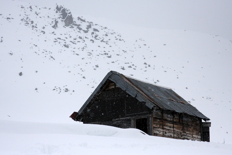 A small, empty, and undecorated cabin that has provided shelter for thousands in the many years it has been here.