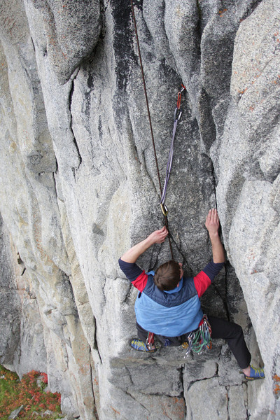 Richard took a few minutes to find the solution to the crux, eventually spreading his weight out to the left on nonexistent footholds and using less arm muscle to pull through.