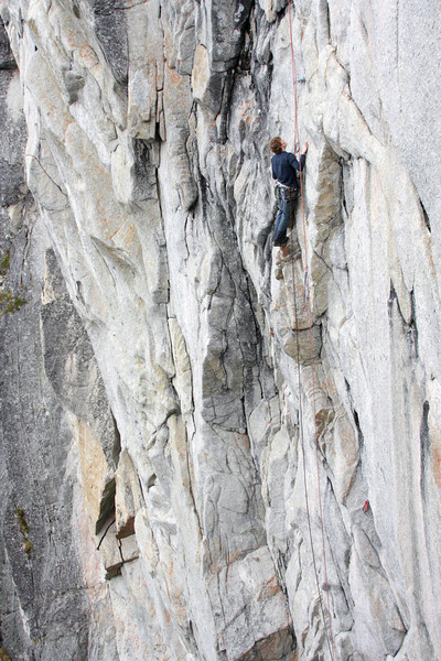 Scott works his way up a difficult 5.10.