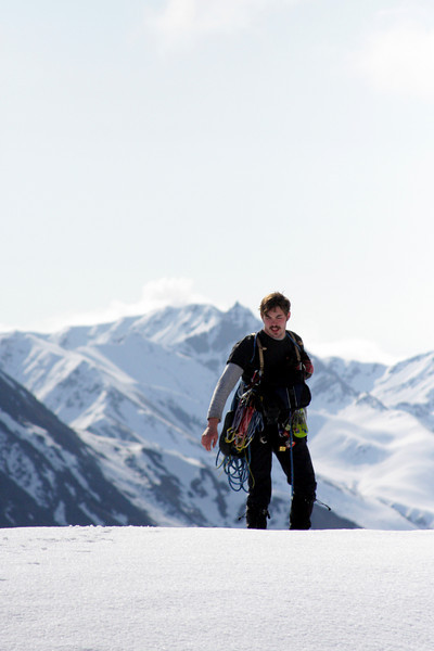 Richard tops out on a small hill with the beautiful mountains of Archangel Valley all around him.