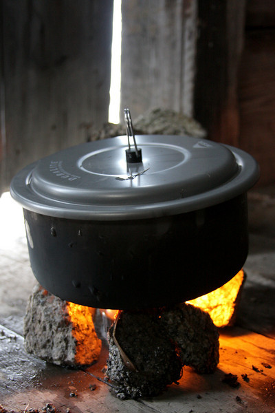 Soup boils over our tin-can stove.