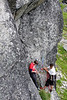 Richard and Kelsey rearrange gear at the anchors on the first pitch of this route.