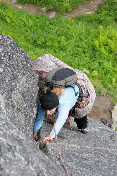 Tracy moves her way up the mildly moistened rock toward the anchor on <i>The Slot 5.7</i>.