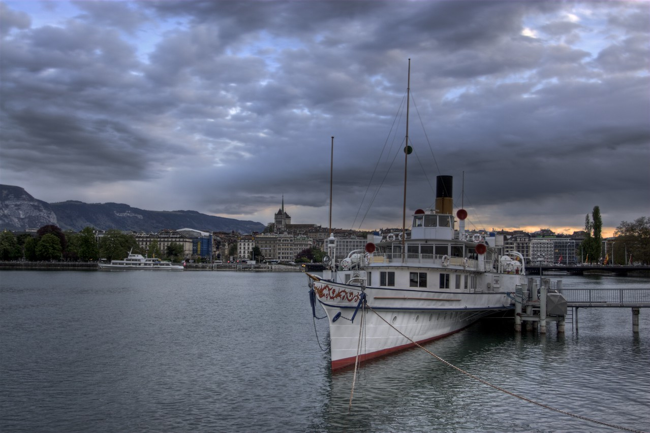Moody • One of the paddle steamers operated by the Compagnie Générale de Navigation sur le lac Léman (CGN) as a ferry to multiple points around the lake in Switzerland and France sits moored on the north-west shore of Lake Geneva.